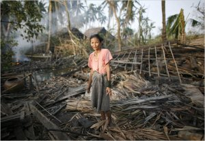 Devastation - A Woman in her cyclone-destroyed house south of Yangon, Myanmar.