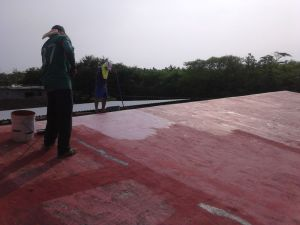 applying sealant to Juluchuca kindergarten